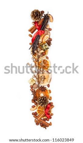 """Letter """"I"""" made of Christmas spices, dry orange and apple slices and small gifts. Isolated on white background - stock photo"""