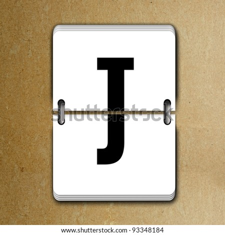 Letter J from mechanical scoreboard alphabet - stock photo
