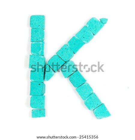 Letter K from cyan stones on white