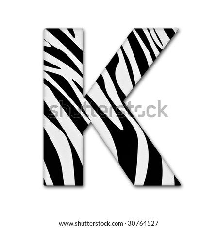 Letter K from the alphabet. Made of animal print. It has a clipping path. - stock photo