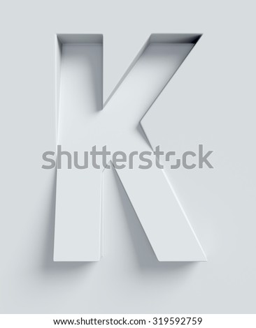 Letter K slanted 3d font engraved and extruded from the surface - stock photo