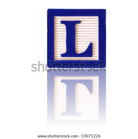 letter L in an alphabet wood block on a reflective surface - stock photo