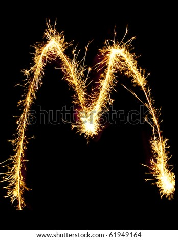 Letter M made of sparklers isolated on black - stock photo