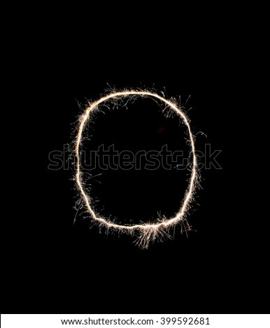 Letter O drawn with sparks on a black background. - stock photo