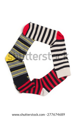 Letter  O made from colorfull socks isolated on white - stock photo