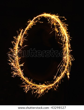 Letter O made of sparklers isolated on black - stock photo