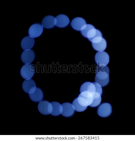 "letter of Christmas lights on a dark background, the letter Q, ""blue bokeh"" - stock photo"