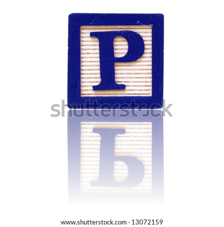 letter p in an alphabet wood block on a reflective surface - stock photo