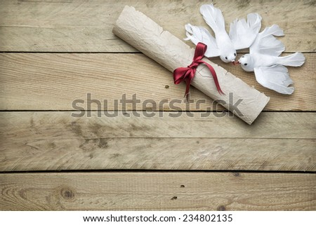 Letter paper and peace doves on wooden background - stock photo