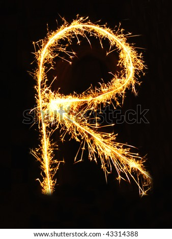 Letter R made of sparklers isolated on black - stock photo