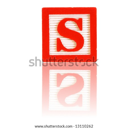 letter s in an alphabet wood block on a reflective surface - stock photo