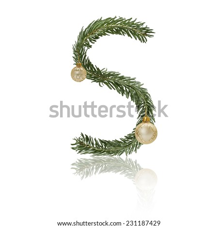Letter S made from fir branches, decorated with christmas balls and reflection. - stock photo