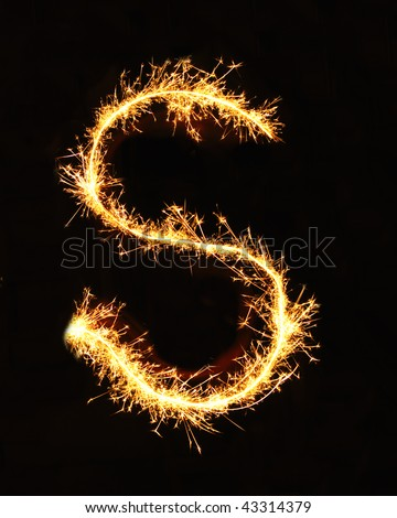 Letter S made of sparklers isolated on black - stock photo