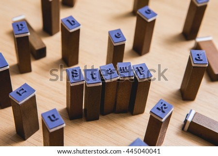"Letter spelling the words ""stamp"" on wooden stamper - stock photo"