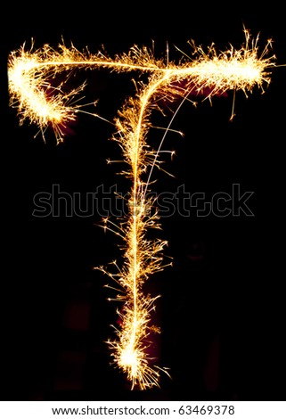 Letter T made of sparkler - stock photo