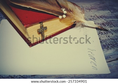 Letter to God and rosary over an old holy bible -  Vintage stylized photo - stock photo