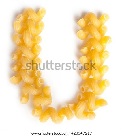 Letter U made from macaroni under a daylight isolated on white background