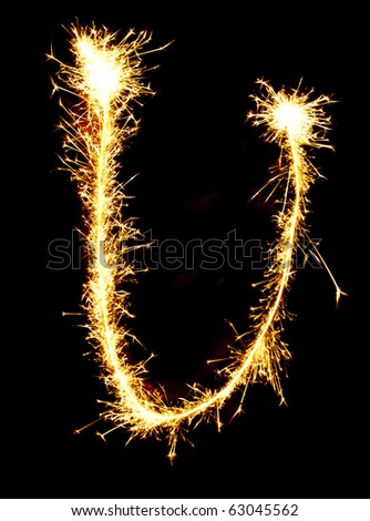 Letter U made of sparkler - stock photo