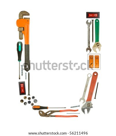 Letter 'U' made of tools isolated on white - stock photo