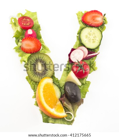 Letter V made of salad and fruits.