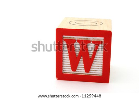 letter w in an alphabet wood block on a white surface - stock photo