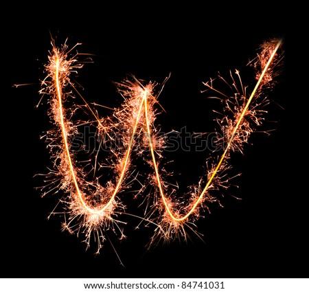 Letter W. Real sparkler alphabet - stock photo