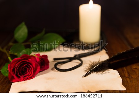 letter, whip, candle and rose - stock photo