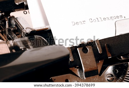 Letter with a title Dear Colleagues typed on old typewriter - stock photo