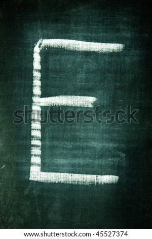 letter written with a chalk on a blackboard - stock photo