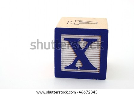 letter x of an alphabet block over a white surface - stock photo