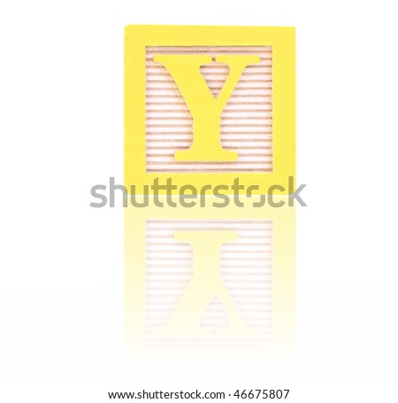 letter y in an alphabet wood block on a reflective surface - stock photo