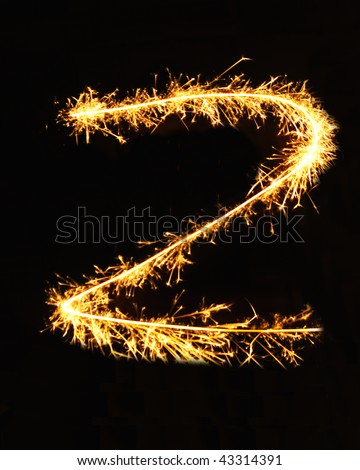 Letter Z made of sparklers isolated on black - stock photo