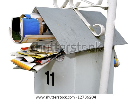 Letterbox jammed full with junk mail - stock photo