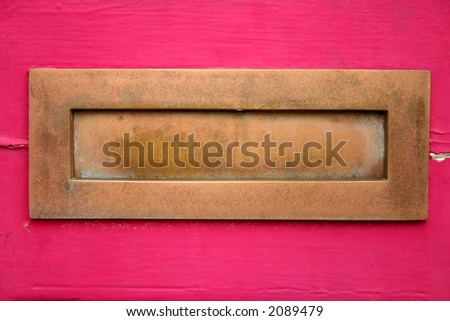 Letterbox on a pink door - stock photo