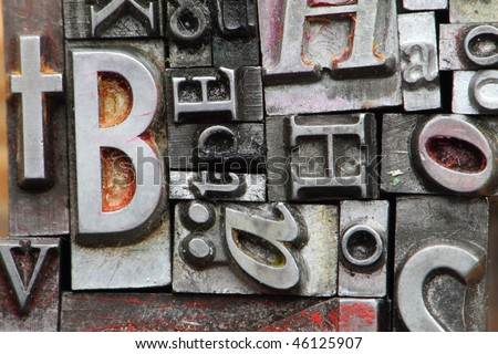 letterpress type on with random letters. - stock photo