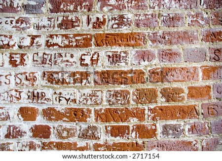 Letters carved in a bricks wall - stock photo