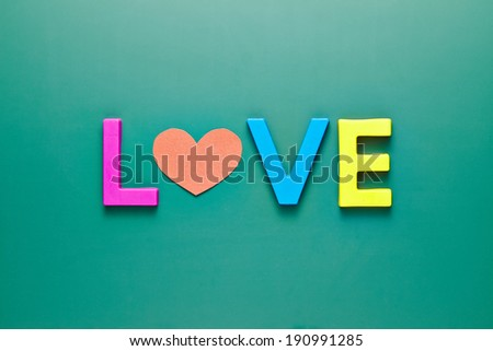 letters forming word LOVE written on green blackboard - stock photo