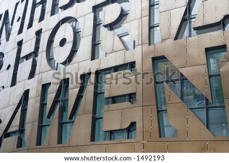 Letters in the Facade of the new Welsh arts centre in Cardiff Bay, Wales , UK. - stock photo