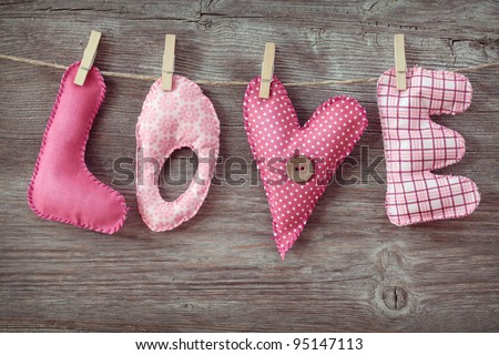 Letters love on wooden background - stock photo