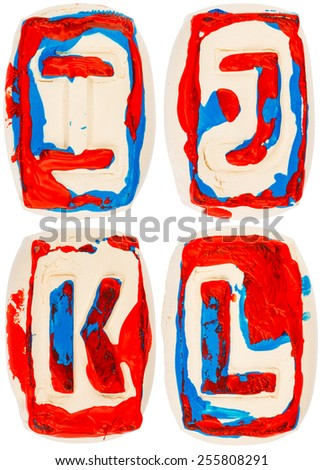 Letters made of white clay  painted with colorful acrylic paints isolated on white - stock photo