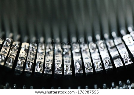 letters on a vintage typewriter - stock photo