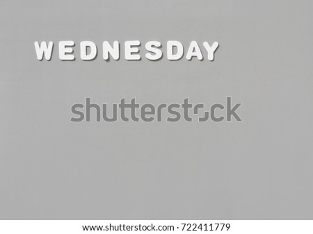 Letters on gray background form the text Wednesday