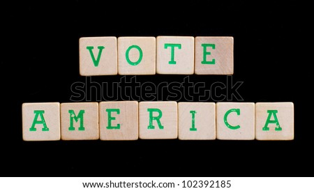 Letters on wooden blocks (America, vote)