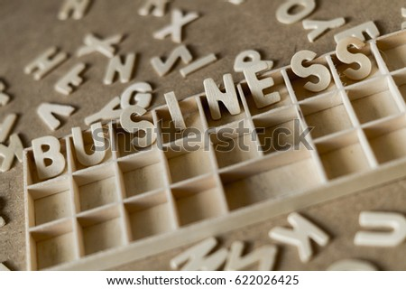 "Letters on wooden table. ""Business""."