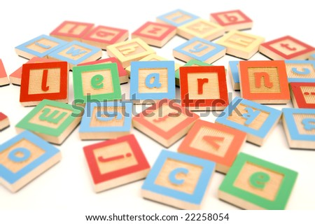 Letters scattered on white background with learn spelled out