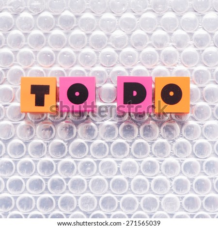 Letters with the words to do. Conceptual image of goals, priorities and management. - stock photo