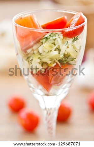 lettuce, cabbage, tomatoes and salted salmon in a glass
