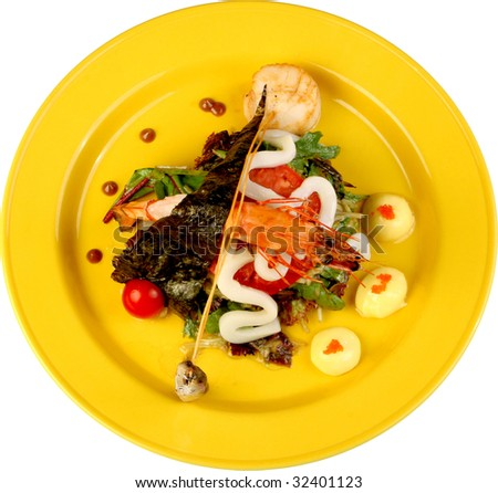 lettuce with a shrimp by a squid, fish and red caviar - stock photo