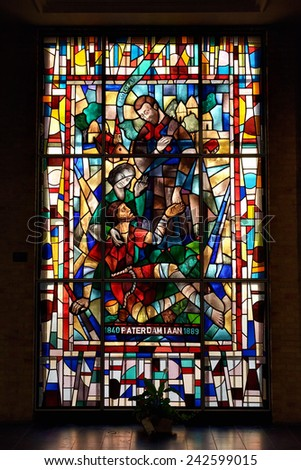 LEUVEN, BELGIUM-SEPTEMBER 12, 2014: Stained glass window in Saint Antony's Chapel. The chapel was built in about 1329 - stock photo