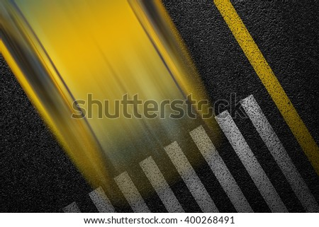 Level asphalted road with a dividing stripes, pedestrian crossing and moving with high speed a yellow car. The texture of the tarmac, top view. - stock photo